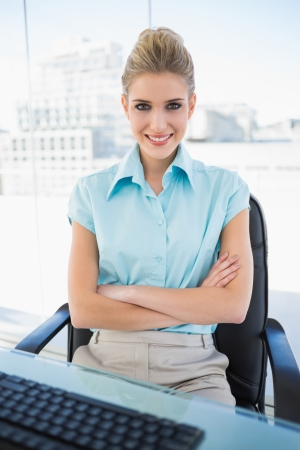 Happy classy businesswoman crossing arms in bright office Stock Photo - 22301841