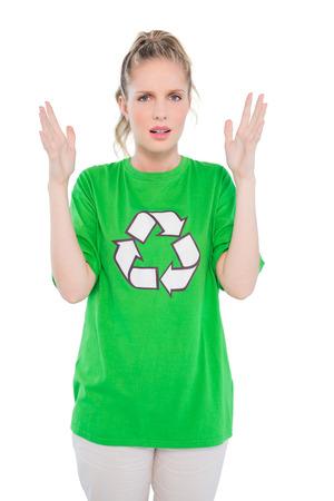 activist: Annoyed blonde activist wearing recycling tshirt posing on white background