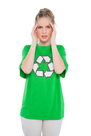 restless: Frowning environmental activist wearing recycling tshirt posing on white  Stock Photo