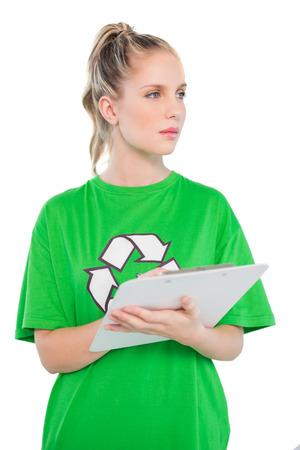 activist: Thoughtful blonde activist holding clipboard on white