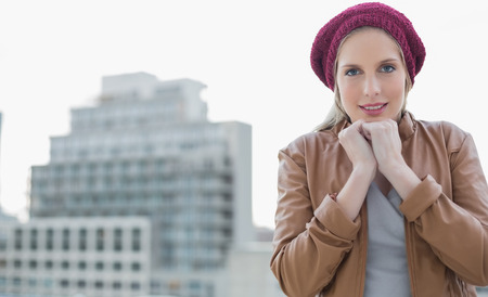 shivering: Shivering casual blonde posing outdoors  Stock Photo