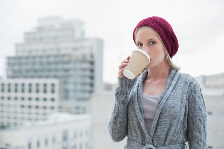 Relaxed casual blonde drinking coffee outdoors  photo