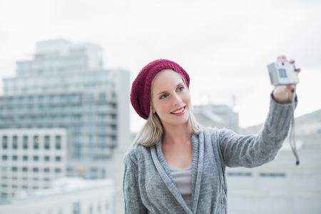 Cheerful pretty blonde taking a self picture  photo