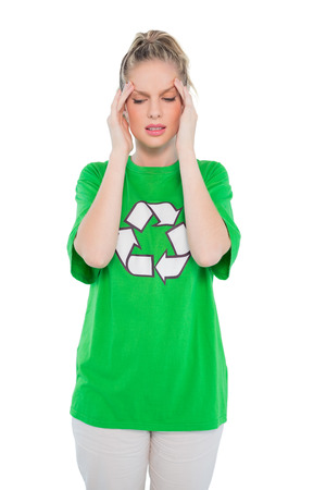 frowning: Frowning blonde activist wearing recycling tshirt posing on white background