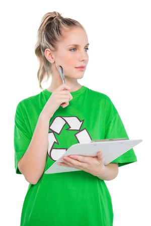 Thinking blonde activist holding clipboard on white  photo