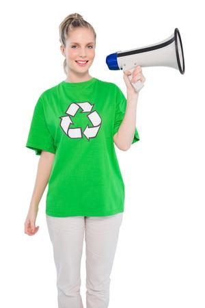 Smiling environmental activist holding megaphone on white background photo
