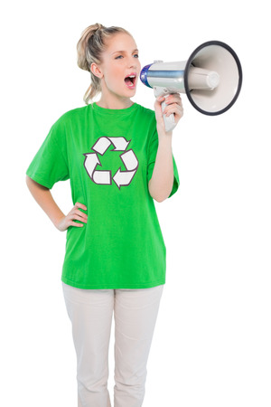 Energetic environmental activist shouting in megaphone on white  photo