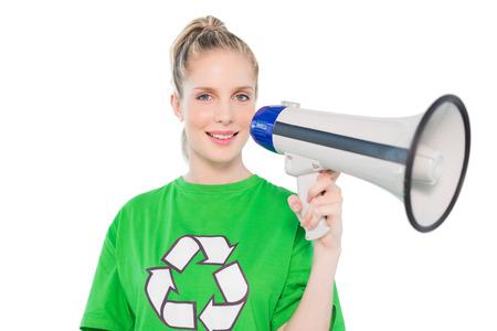 Cheerful environmental activist holding megaphone on white  photo