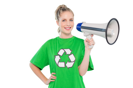 Happy environmental activist holding megaphone on white background photo