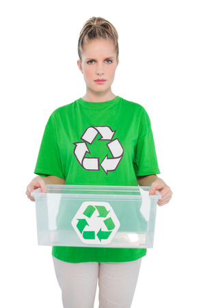 Frowning environmental activist holding empty recycling box on white  photo