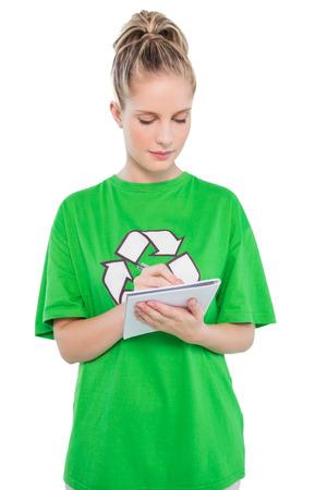 activist: Focused environmental activist taking notes on white  Stock Photo