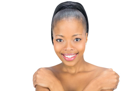 nude black women: Attractive black woman smiling at camera against white