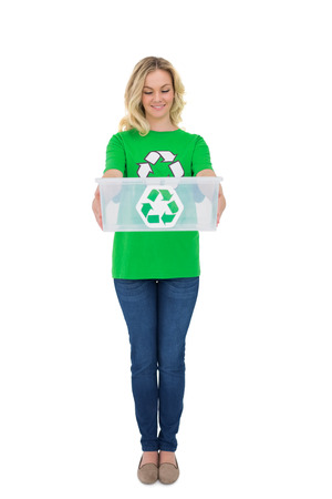 Smiling cute environmental activist holding recycling box on white  photo