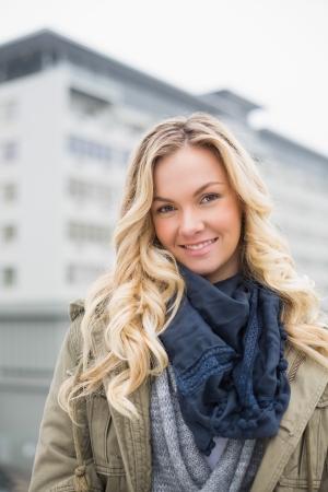 Smiling trendy blonde posing outdoors  Stock Photo