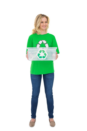 Smiling pretty environmental activist holding recycling box on white background photo