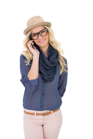 Happy trendy blonde on the phone on white  photo