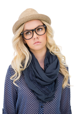 Serious trendy blonde with classy glasses posing on white  photo