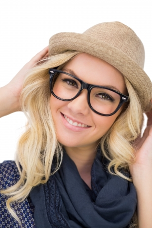 Cheerful trendy blonde with classy glasses posing on white  photo