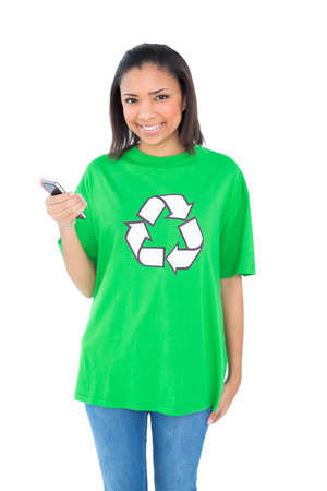 dark haired: Content dark haired environmental activist holding a mobile phone on white  Stock Photo