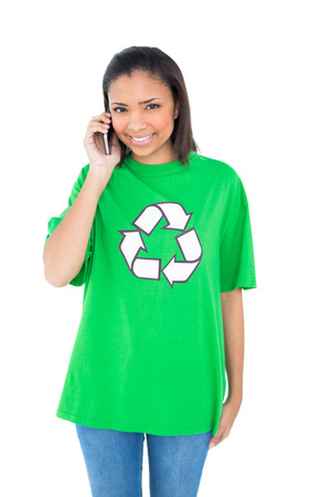 Cheerful dark haired environmental activist making a phone call on white  photo