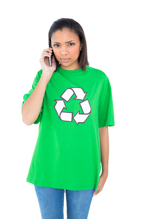 dark haired: Serious dark haired environmental activist making a phone call on white