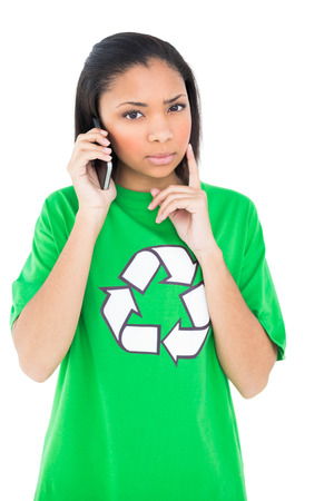 dark haired: Thoughtful dark haired environmental activist making a phone call on white