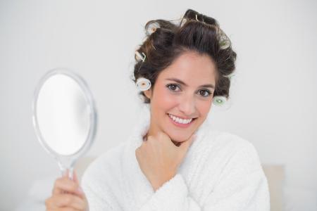 gleeful: Gleeful natural brunette holding hand mirror in bedroom