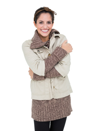 cross armed: Smiling woman in winter fashion standing cross armed on white background Stock Photo