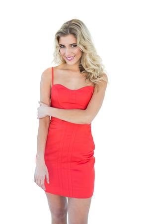 gleeful: Gleeful blonde model looking at camera on white