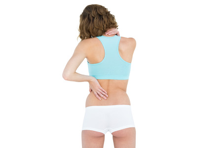 Rear view of slender brunette woman wearing sportswear on white background photo