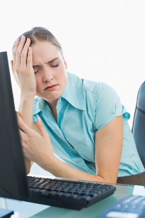 wincing: Classy wincing businesswoman having a headache in bright office Stock Photo