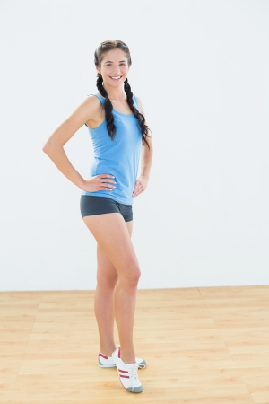 Full length portrait of a slim sporty young woman in sportswear photo