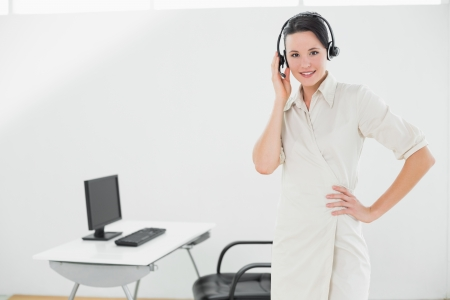 Portrait of an elegant businesswoman wearing headset in the office photo