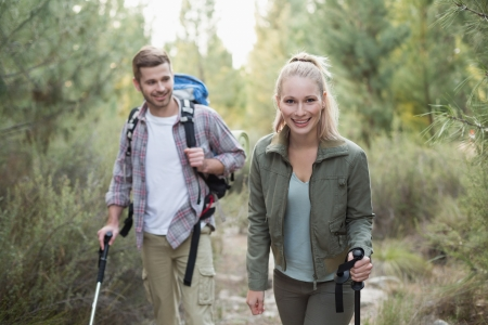 woman hiking: Fit young couple exploring a wooded area in the countryside