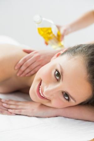 therapeutical: Close up portrait of a beautiful woman enjoying oil massage at beauty spa