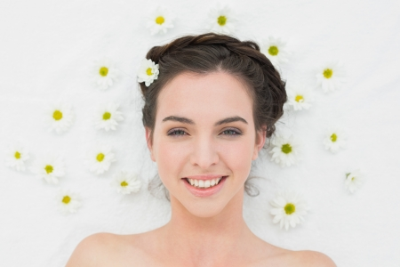 Overhead portrait of a beautiful young woman with flowers in beauty salon photo