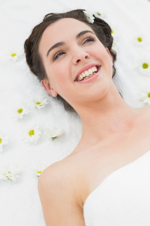 Close up portrait of a beautiful young woman with flowers in beauty salon photo