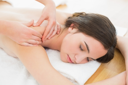 Close up of a beautiful woman enjoying shoulder massage at beauty spa Stock Photo - 25457922
