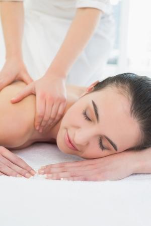 Close up of a beautiful woman enjoying shoulder massage at beauty spa Stock Photo - 25458204