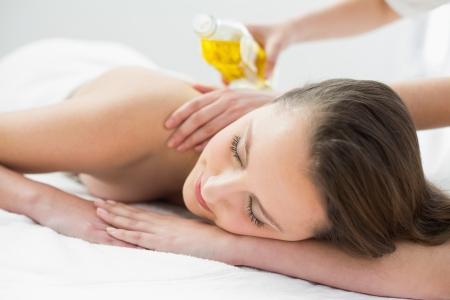 therapeutical: Close up of a beautiful woman enjoying oil massage at beauty spa