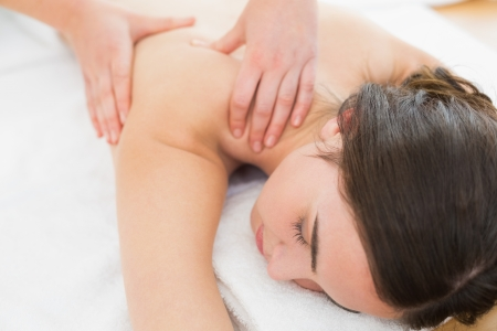 Close up of a beautiful woman enjoying shoulder massage at beauty spa Stock Photo - 25460696