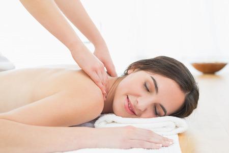 Close up of a beautiful woman enjoying neck massage at beauty spa Stock Photo - 25460701