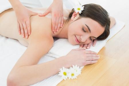 Close up of a beautiful woman enjoying back massage at beauty spa Stock Photo - 25460703