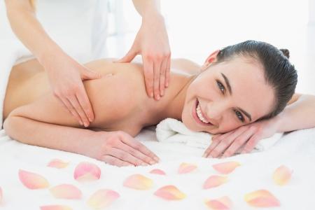 Close up of a beautiful woman enjoying shoulder massage at beauty spa Stock Photo - 25460711
