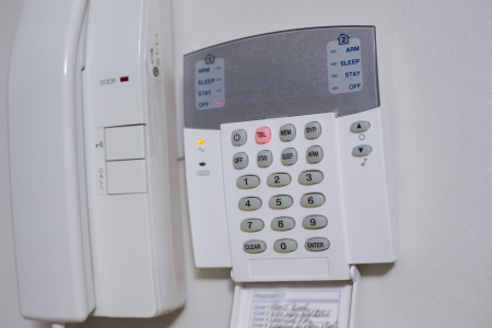important phone call: Close up of a white wall mounted entry phone system Stock Photo