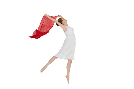 Full length of a young beautiful female dancer with blue scarf against white background photo