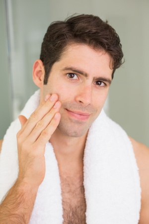 aftershave: Close up portrait of a handsome young man touching his face Stock Photo