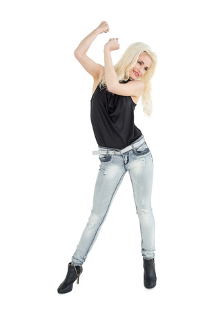 Full length of a happy casual blond dancing over white background photo