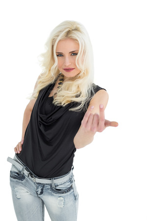 Portrait of young casual woman with blonde hair over white background photo