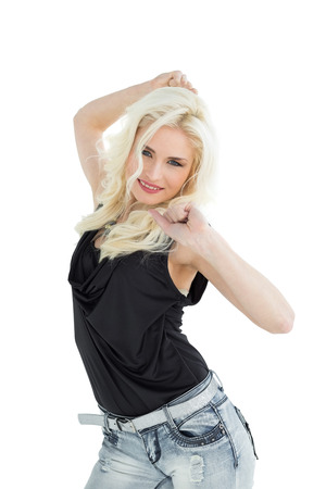 Portrait of happy young casual woman dancing over white background photo